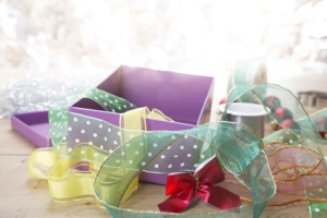 preparing for christmas with gift box and ribbons